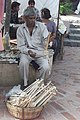 A sarangi vendor plays impeccable musical notes while displaying his wares for sales during the 'Teej Festival' at Dilli Haat in New Delhi on August 07, 2005.jpg