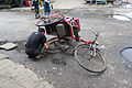 A trishaw being repaired in Yangon.JPG