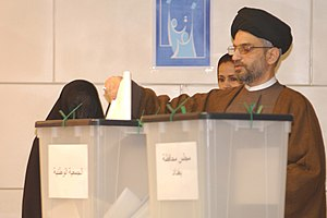 Iraqi parliamentary election, January 2005 - Abdul Aziz al-Hakim at a polling station in Baghdad. His United Iraqi Alliance won the most seats in this election.