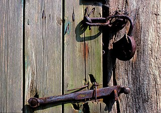 File:Age-worn door latch and lock on well-weathered planks ...