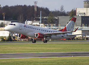 Air Lituanica Embraer170 taking off at Vilnius airport.jpg