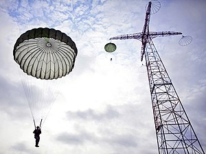 United States Army Airborne School - Students drop from the 250 foot tower in T-10 parachutes during tower week.