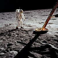 Aldrin inspects the LM landing gear.