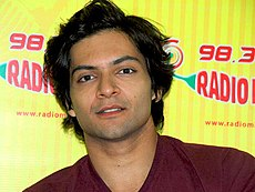 Ali Fazal looking at the camera