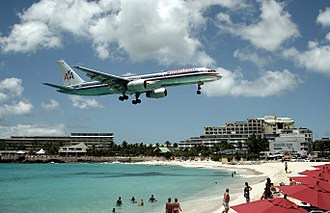 Tourism in the Caribbean - American 757 on final approach to Saint Maarten Airport