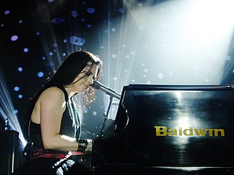 Amy Lee - Lee performing during a concert in 2011