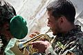 An Afghan National Army soldier assigned to the 203rd Corps band tests a new piccolo trumpet Dec. 14, 2013, at Forward Operating Base Thunder in Paktia province, Afghanistan, Dec. 14, 2013 131214-A-YW808-054.jpg