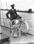 An officer, possibly of the Royal Australian Naval Reserve, and a woman seated on the deck of a ship, 1920-1939 (7688334936).jpg