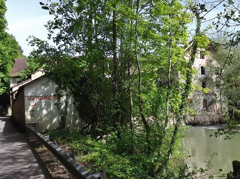 Sight of the ancient paper mills of Geneuille along the Ognon river, near Besançon in Doubs, France.