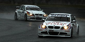 2009 FIA WTCC Race of Japan - Andy Priaulx leads Jörg Müller during Race One.