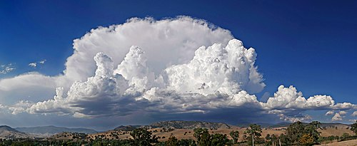 Cumulonimbus capillatus incus cloud floating over Swifts Creek, Victoria in Australia