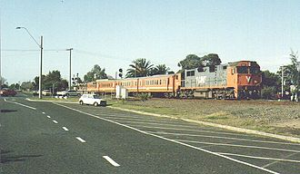 V/Line N class - N class in the original orange and grey livery hauling H type carriages in Geelong in 1993