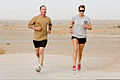 Australian Army Lance Cpl. Shane Kelly, left, and Royal Australian Navy Able Seaman Gemma Stratton participate in the Sand to Sand charity run at Multinational Base Tarin Kowt, Uruzgan province, Afghanistan 130817-O-MD709-255-AU.jpg