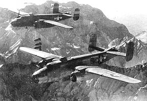379th Bombardment Squadron - Group B-25J Mitchells dropping 1,000 pound bombs over the Brenner Pass in Northern Italy, 1944