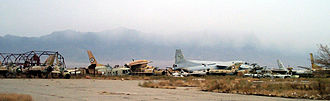 Bagram Airfield - Wrecks of former Soviet and Afghan Air Force (AAF) aircraft line the runway at Bagram Airfield.