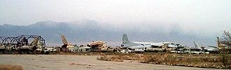 Bagram Airfield - Wrecks of former Soviet and Afghan Air Force (AAF) aircraft line the runway at Bagram Airfield.