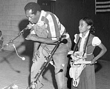 Banjoist and bones player Abner Jay performs with child - White Springs (15405256045).jpg