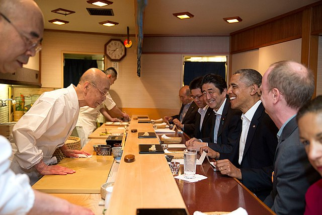 Barack Obama and Shinzo Abe of Japan talk with sushi master Jiro Ono, at Sukiyabashi Jiro sushi restaurant, during a dinner in Tokyo, Japan, April 23, 2014