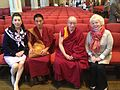 Barbara Sexton Smith, President and CEO of the Fund for the Arts, and Christy Brown meet the Tibetan Monks who chanted at the InterFaith Prayer Service (8880143204).jpg
