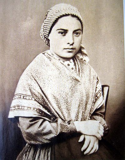 An early studio photograph of Bernadette Soubirous, age 14, in daily civilian attire. Circa 1 January 1858. Bernadette Soubirous.jpg