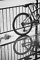 Bike in the rain (18738439593).jpg