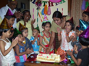 A Childs Birthday Celebration Complete With Cake