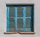 Blue window shutter in the Arab Quarter, North Nicosia, Cyprus.jpg