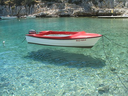 Boat on clear water at island Šolta.jpg