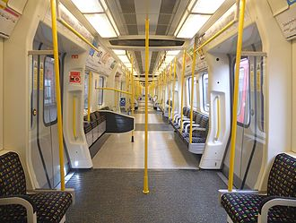 London Underground S7 and S8 Stock - The interior of a London Underground Circle line S7 Stock train, showing the wheelchair parking places
