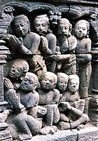 A detailed carved relief stone from Borobudur.