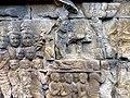 Borobudur - Divyavadana - 081 N, King Sikhandi orders his people to throw dust on Ven Mahakatyayana (detail 3) (11706251944).jpg