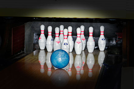 A bowling ball about to strike some bowling pins on a bowling alley Bowling - albury.jpg