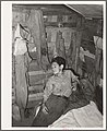 Boy in corner of shack home near Mays Avenue. Oklahoma City, Oklahoma.jpg