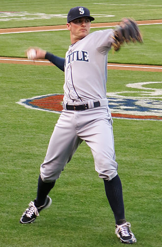 Brendan Ryan (baseball) - Ryan, during his tenure with the Seattle Mariners in 2013, warms up before a game against the Oakland Athletics in Oakland
