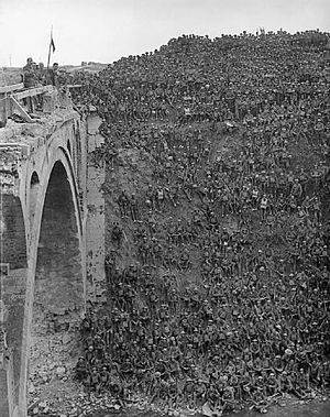 46th (North Midland) Division - Brig-Gen J. V. Campbell on Riqueval Bridge addresses men of 137th Brigade after breaking the German's Hindenburg Line defences on 29 September 1918