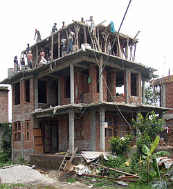 Building a house nearby the street between Kathmandu and-Nagarkot