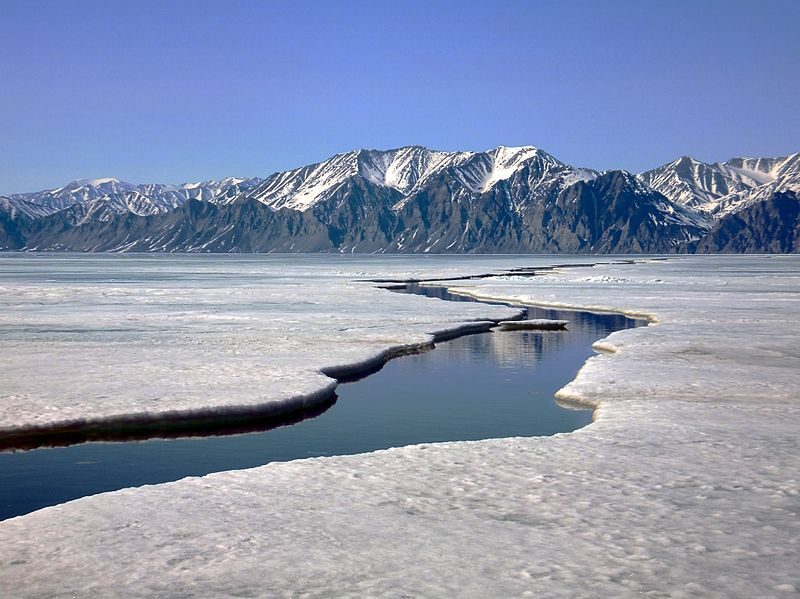 Bylot Island from sea ice, crack in the ice leading to the mountains, Sirmilik National Park, Nunavut
