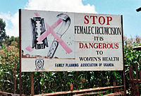 Campaign against female genital mutilation – a road sign near Kapchorwa, Uganda