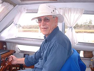 Canadian writer Silver Donald Cameron at the wheel of Magnus, the ketch he sailed to the Bahamas in 2004.jpg