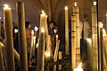 Candles and pilgrims in a pavilion near Sanctuary of Our Lady of Lourdes, 9 August 2019.jpg