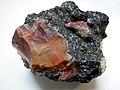 Carnelian jasper - SiO2, on melaphyre rock (32741299474).jpg