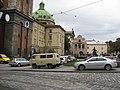 Cars on a sidewalk in Lviv, Ukraine.jpg