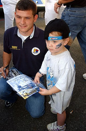 Casey Atwood - Atwood posing with a young fan at Dover in 2004, courtesy of the U.S. Navy