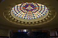 Cathedral of Christ the King (Lexington, Kentucky), interior, baptismal font and stained glass.jpg