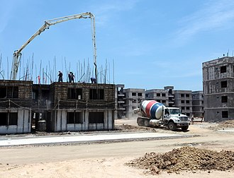 Cemex - Cemex ready-mix truck departing jobsite after dispensing concrete for a multi-storey residential project. The location is Villahermosa, Mexico.