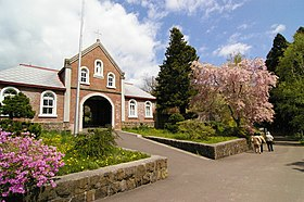 Cherry blossoms and the Gate of Entrance of Tobetsu Trappist Monastery.JPG