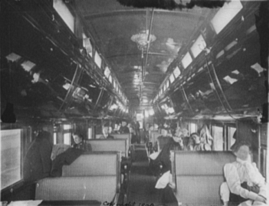 Interior of a Pullman car on the Chicago and Alton Railroad, c. 1900, configured for daytime operation Chicago and Alton Railroad Pullman car interior c 1900.png