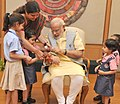 Children tying 'Rakhi' on the Prime Minister, Shri Narendra Modi's wrist, on the occasion of 'Raksha Bandhan', in New Delhi on August 29, 2015 (5).jpg