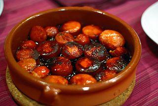 https://upload.wikimedia.org/wikipedia/commons/thumb/9/98/Chorizo_a_la_sidra.jpg/320px-Chorizo_a_la_sidra.jpg