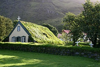 Church of Iceland - A small wood and turf church in Hof.